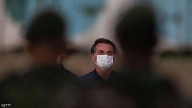 """Photo of """"جبناء"""".. رئيس البرازيل ينفعل بعد 100 ألف وفاة بكورونا"""